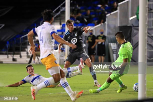 Aaron Schoenfeld of Minnesota United takes a shot on goal stopped by Daniel Vega of San Jose Earthquakes during a quarter final match of MLS Is Back...