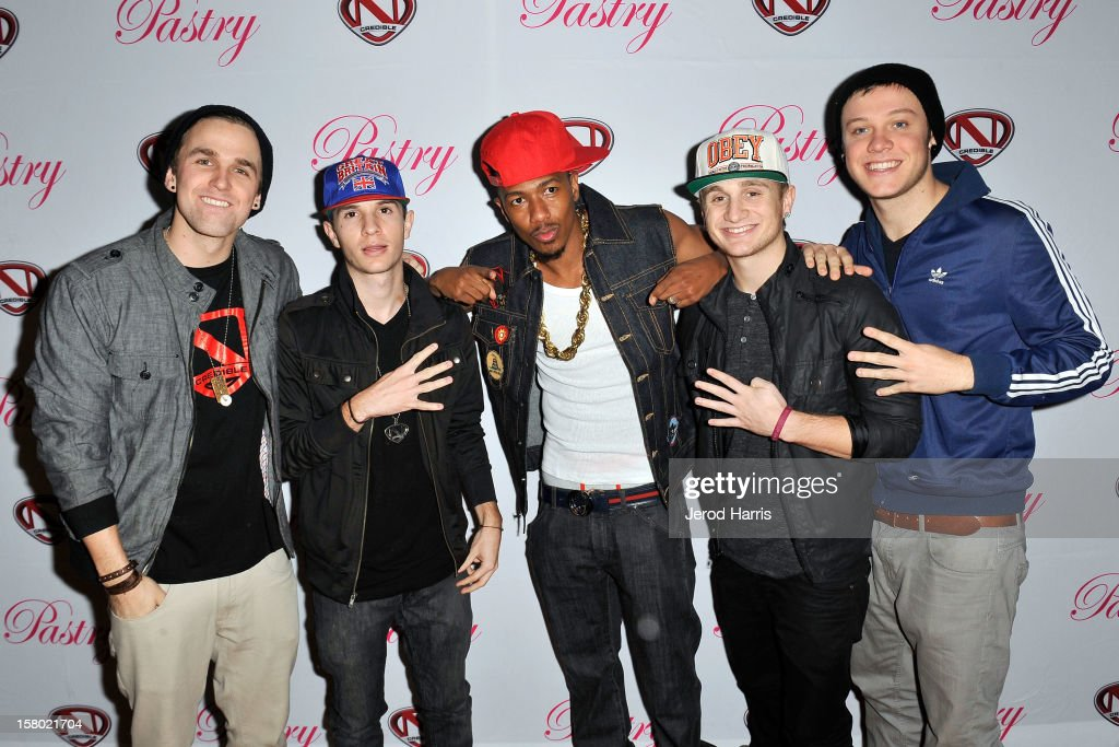 Aaron Scott, Kieran Ackerman, Nick Cannon, Adam Ackerman and Ben Robinson of 4count arrive at Pastry Shoes 'Skate & Donate' benefitting Toys For Tots on December 8, 2012 in Glendale, California.