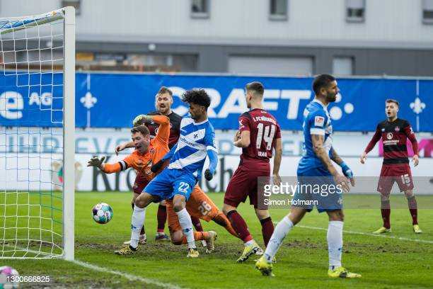 Aaron Seydel of Darmstadt scores a disallowed goal past Goalkeeper Christian Mathenia of Nuernberg during the Second Bundesliga match between SV...