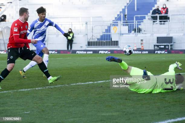 Aaron Seydel of Darmstadt scores his team's first goal past goalkeeper Michael Esser of Hannover during the Second Bundesliga match between SV...