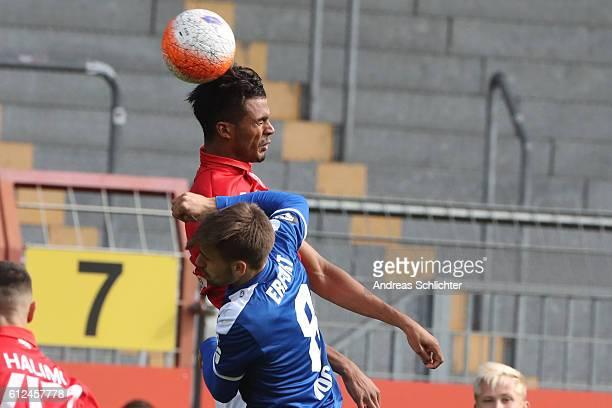 Aaron Seydel of FSV Mainz 05 II challenges Liridon Vocaj of RW Erfurt during the Third League match between 1FSV Mainz 05 II and RW Erfurt at...