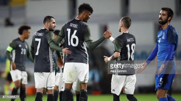 Aaron Seydel of Germany celebrates his team's third goal with team mates Marcel Hartel and Levin Oeztunali during the UEFA Under21 Euro 2019...