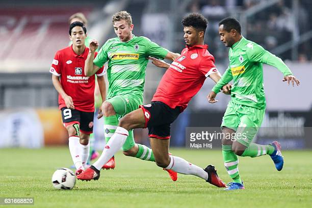 Aaron Seydel of Mainz is challenged by Christoph Kramer and Raffael of Moenchengladbach during the Telekom Cup 2017 match between Borussia...