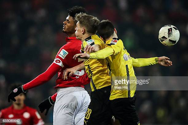 Aaron Seydel of Mainz Matthias Ginter of Dortmund and Julian Weigl of Dortmund fight for the ball during the Bundesliga Julian Weigl of Dortmund...