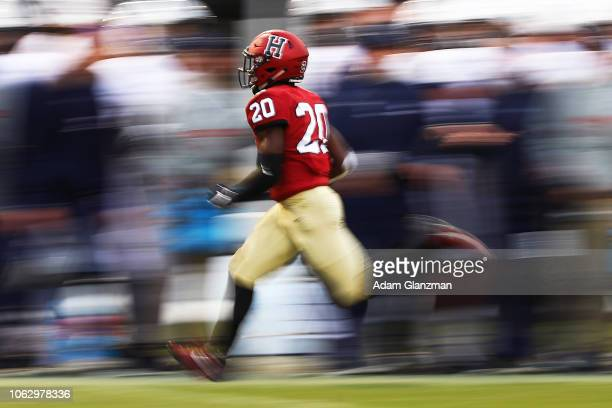 Aaron Shampklin of the Harvard Crimson runs with the ball during a game against the Yale Bulldogs at Fenway Park on November 17 2018 in Boston...
