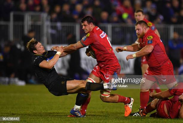 Aaron Shingler of Scarlets bumps off Chris Cook of Bath during the European Rugby Champions Cup match between Bath Rugby and Scarlets at the...