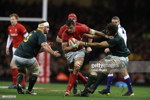 Aaron Shingler of Wales holds off Lood de Jager of South Africa and Wilco Louw of South Africa during the international match match between Wales and...