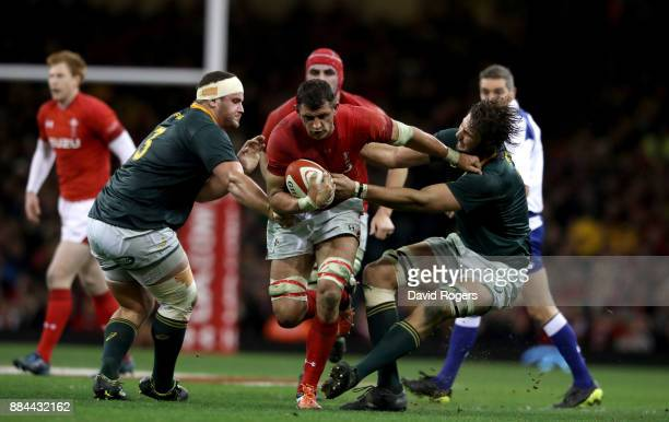 Aaron Shingler of Wales holds off Wilco Louw of South Africa and Lood de Jager of South Africa during the international match match between Wales and...