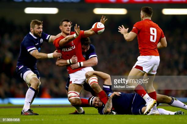 Aaron Shingler of Wales looks to offload as he is tackled by Jon Welsh of Scotland and Gordon Reid of Scotland during the Natwest Six Nations round...