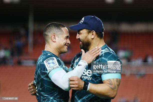 Aaron Smith and Ash Dixon of the Highlanders celebrate after winning the round 6 Super Rugby Aotearoa match between the Chiefs and the Highlanders at...