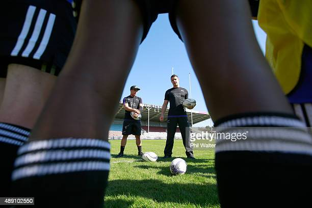 Aaron Smith and Daniel Carter of the All Blacks interact with young rugby players during an adidas Force of Black event at Twickenham Stoop on...