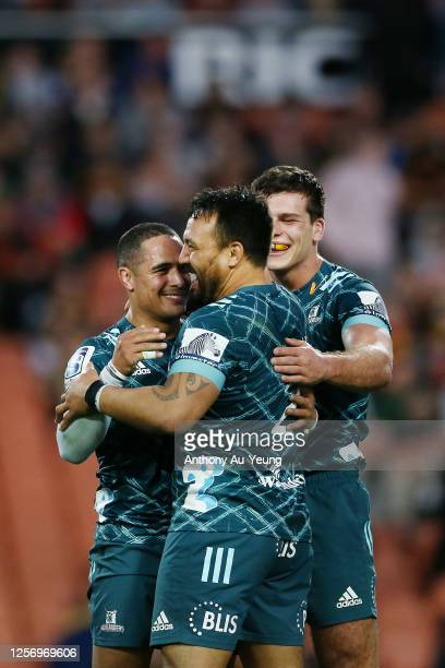 Aaron Smith, Ash Dixon and Dillon Hunt of the Highlanders celebrate after winning the round 6 Super Rugby Aotearoa match between the Chiefs and the...