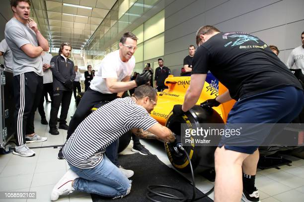 Aaron Smith, Ben Smith and Dane Coles take part in a Pit Stop tire change competition on a Formula One race car during a New Zealand All Blacks visit...