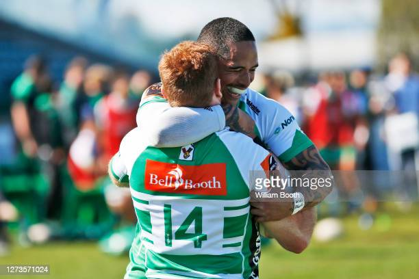 Aaron Smith congratulates Jamie Booth on his try during the round 2 Mitre 10 Cup match between Manawatu and Otago at Central Energy Trust Arena on...