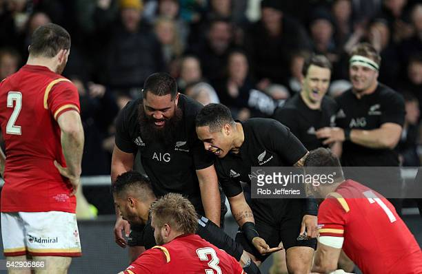 Aaron Smith of New Zealand celebrates the try of George Moala during the International Test match between the New Zealand All Blacks and Wales at...