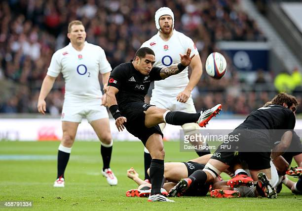 Aaron Smith of New Zealand clears the ball upfield during the QBE International match between England and New Zealand at Twickenham Stadium on...