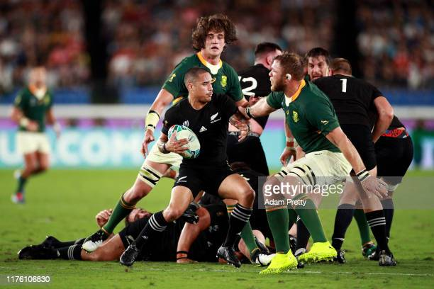 Aaron Smith of New Zealand is tackled during the Rugby World Cup 2019 Group B game between New Zealand and South Africa at International Stadium...