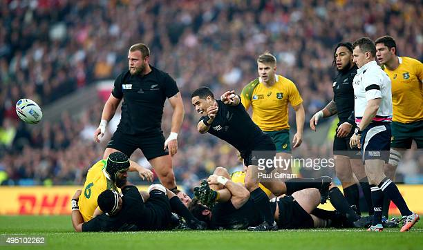 Aaron Smith of New Zealand passes from the ruck during the 2015 Rugby World Cup Final match between New Zealand and Australia at Twickenham Stadium...