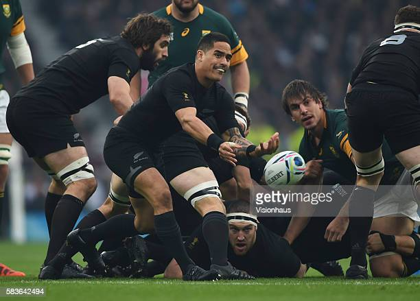Aaron Smith of New Zealand passes the ball out during the Rugby World Cup semi final match between South Africa and New Zealand at the Twickenham...