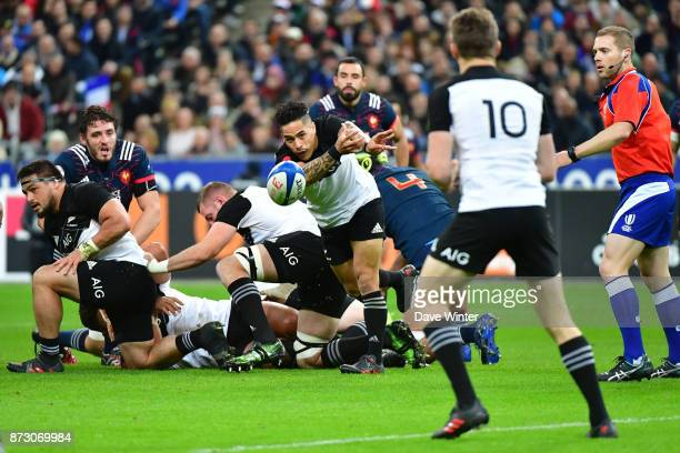 Aaron Smith of Nez Zealand feeds Beauden Barrett of New Zealand during the test match between France and New Zealand at Stade de France on November...