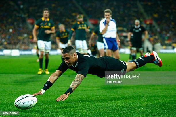 Aaron Smith of the All Blacks attempts to get a touch on the ball during The Rugby Championship match between the New Zealand All Blacks and the...