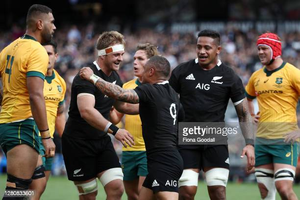 Aaron Smith of the All Blacks celebrates his try with Sam Cane captain of the All Blacks during the Bledisloe Cup match between the New Zealand All...