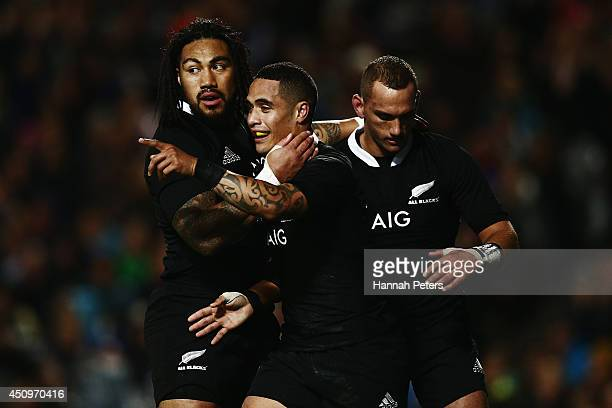 Aaron Smith of the All Blacks celebrates with Ma'a Nonu and Aaron Cruden after scoring his second try during the International Test match between the...