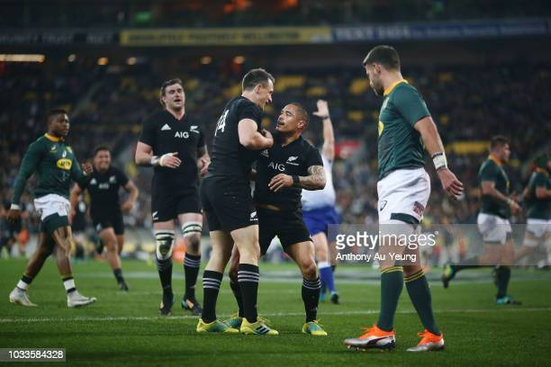 Aaron Smith of the All Blacks celebrates with teammate Ben Smith after scoring a try during The Rugby Championship match between the New Zealand All...