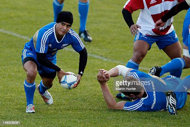 Aaron Smith of the All Blacks looks to pass during a New Zealand All Blacks training session at Linfield Park on June 14 2012 in Christchurch New...