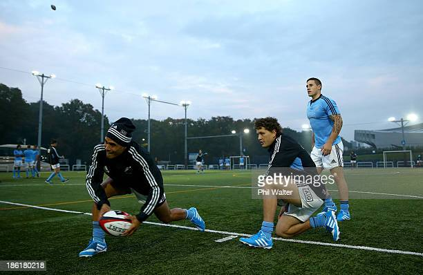 Aaron Smith of the All Blacks passes during a New Zealand All Blacks training session at the Yoyogi Gymnasium on October 29 2013 in Tokyo Japan