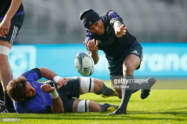 Aaron Smith of the All Blacks passes during a New Zealand All Blacks Captain's Run at Eden Park on August 14 2015 in Auckland New Zealand