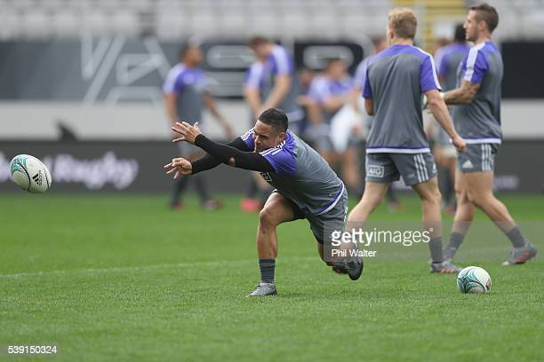 Aaron Smith of the All Blacks passes during the New Zealand All Blacks Captain's Run at Eden Park on June 10 2016 in Auckland New Zealand