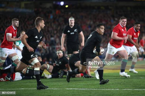 Aaron Smith of the All Blacks passes during the Test match between the New Zealand All Blacks and the British Irish Lions at Eden Park on June 24...