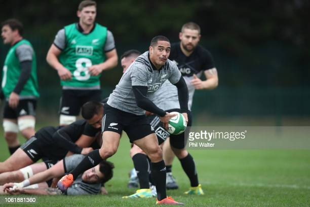 Aaron Smith of the All Blacks passes the ball during a New Zealand All Black training session at the Ireland Sport Institute on November 15 2018 in...