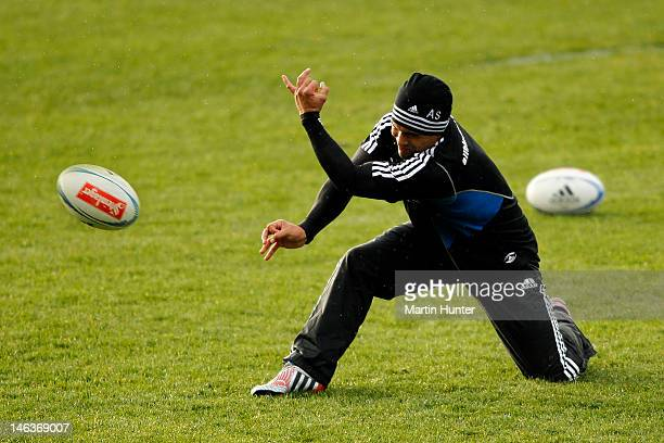 Aaron Smith of the All Blacks passes the ball during a New Zealand All Blacks training session at AMI Stadium on June 15 2012 in Christchurch New...