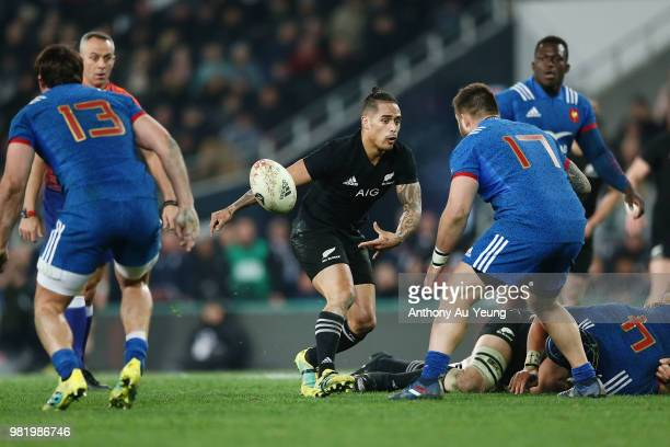 Aaron Smith of the All Blacks with a pass during the International Test match between the New Zealand All Blacks and France at Forsyth Barr Stadium...
