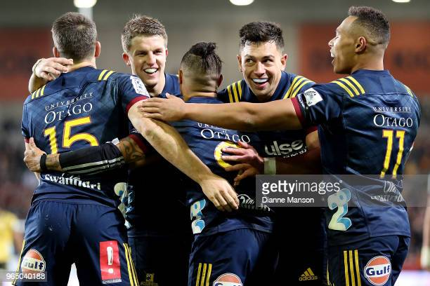 Aaron Smith of the Highlanders celebrates his try with team mates during the round 16 Super Rugby match between the Highlanders and the Hurricanes at...