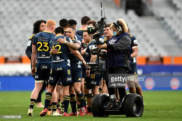 Aaron Smith of the Highlanders celebrates with his team after winning the round 10 Super Rugby Aotearoa match between the Highlanders and the...