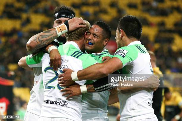 Aaron Smith of the Highlanders congratulates Matt Faddes on his try during the round four Super Rugby match between the Hurricanes and the...