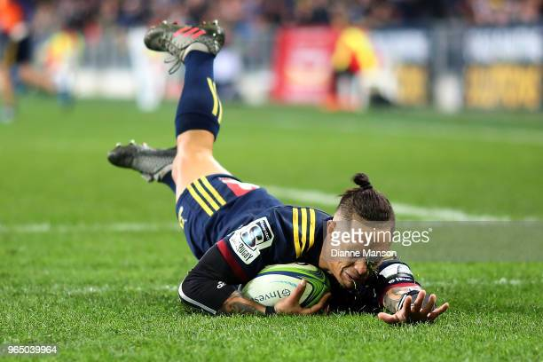 Aaron Smith of the Highlanders dives over to score a try during the round 16 Super Rugby match between the Highlanders and the Hurricanes at Forsyth...