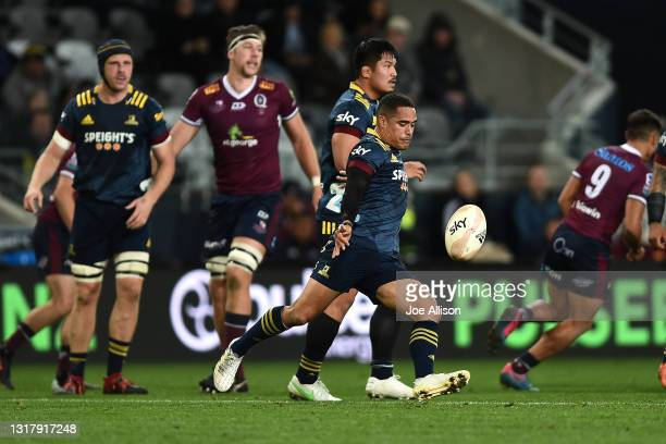Aaron Smith of the Highlanders kicks the ball during the round one Super Rugby Trans-Tasman match between the Highlanders and the Queensland Reds at...