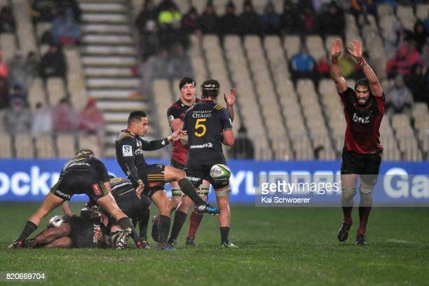 Aaron Smith of the Highlanders kicks the ball during the Super Rugby Quarter Final match between the Crusaders and the Highlanders at AMI Stadium on...