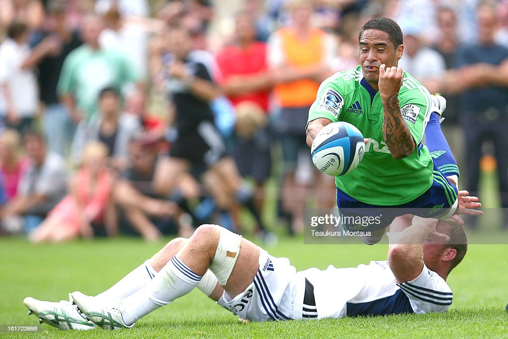 Aaron Smith of the Highlanders passes during the Super Rugby trial match between the Highlanders and the Blues at the Queenstown Recreation Ground on February 15, 2013 in Queenstown, New Zealand.