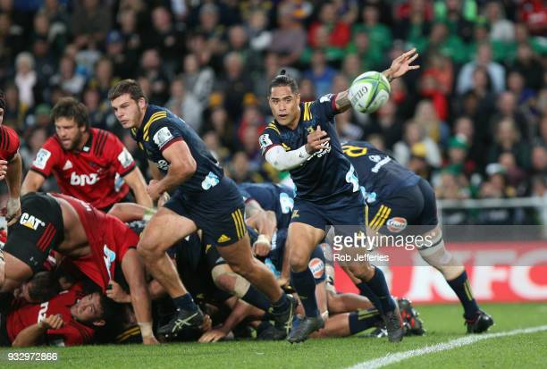 Aaron Smith of the Highlanders passes the ball during the round five Super Rugby match between the Highlanders and the Crusaders at Forsyth Barr...
