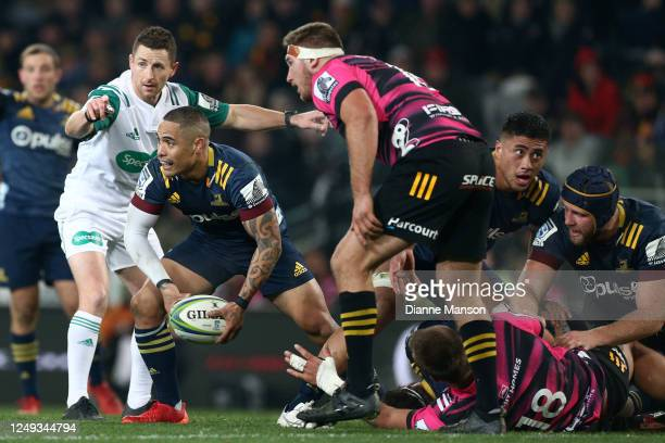 Aaron Smith of the Highlanders passes the ball out during the round 1 Super Rugby Aotearoa match between the Highlanders and Chiefs at Forsyth Barr...