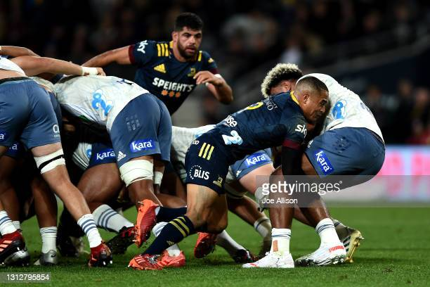 Aaron Smith of the Highlanders tackles Hoskins Sotutu of the Blues during the round eight Super Rugby Aotearoa match between the Highlanders and the...