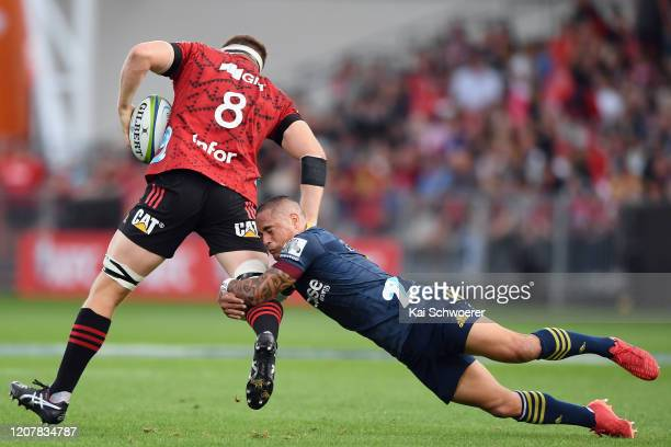 Aaron Smith of the Highlanders tackles Tom Sanders of the Crusaders during the round four Super Rugby match between the Crusaders and Highlanders at...
