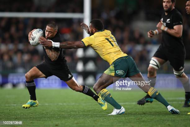 Aaron Smith of the New Zealand All Blacks beats the tackle of Marika Koroibete of the Australian Wallabies during The Rugby Championship game between...