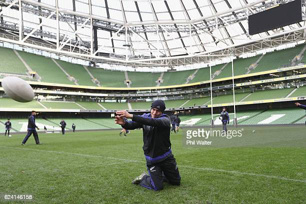 Aaron Smith of the New Zealand All Blacks passes the ball during the Captains Run at Aviva Stadium on November 18 2016 in Dublin Ireland
