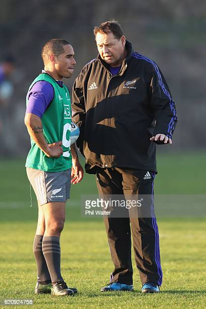 Aaron Smith of the New Zealand All Blacks talks with coach Steve Hansen during a training session at Toyota Park on November 3 2016 in Chicago...